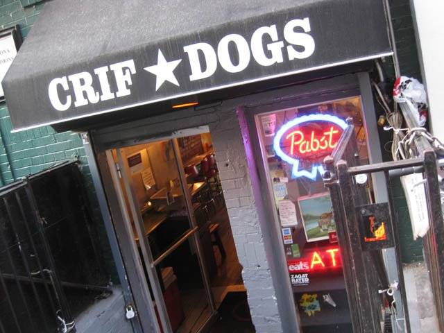 at-pdt-you-can-sip-on-your-cocktails-while-munching-on-a-signature-crif-dogs-hot-dog